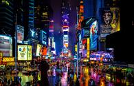 Times Square in New York on a rainy night. (schalkm / iStock / Getty Images Plus)
