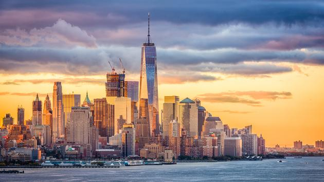 New York City financial district on the Hudson River at dawn. (Sean Pavone / iStock / Getty Images Plus)
