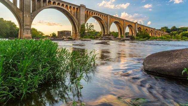 This concrete arch railroad bridge spanning the James River was built by the Atlantic Coast Line, Fredericksburg and Potomac Railroad in 1919 to route transportation of freight around Richmond, VA. (photo via Xavier_Ascanio / iStock / Getty Images Plus)