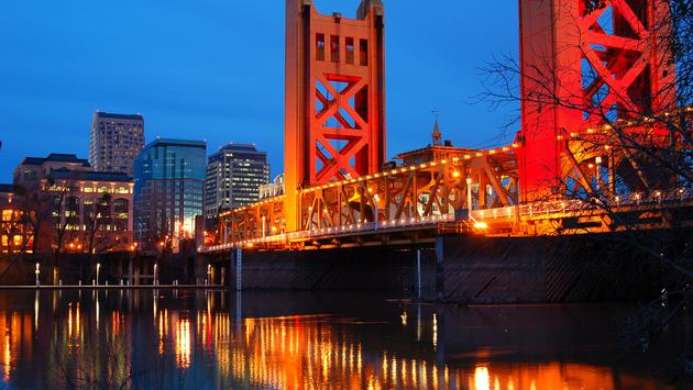 The historic Tower Bridge spans the Sacramento River in the California Capital (photo via Kirkikis / iStock / Getty Images Plus)