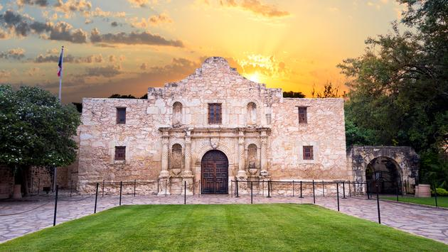 Exterior view of the historic Alamo shortly after sunrise (photo via Dean_Fikar / iStock / Getty Images Plus)