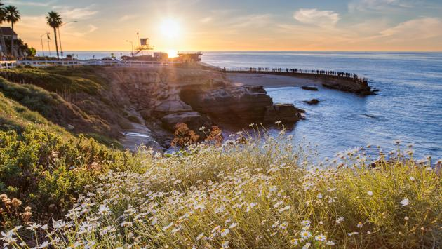 Sunset at La Jolla cove beach, San Diego, California (photo via kanonsky / iStock / Getty Images Plus)