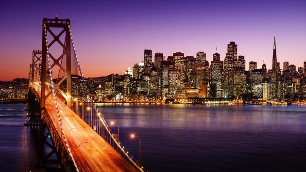 San Francisco skyline and Bay Bridge at sunset, California (photo via dell640 / iStock / Getty Images Plus)