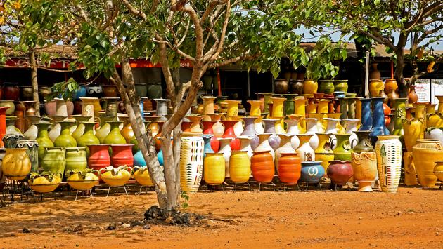 Colorful pottery at an outdoor market in Accra Ghana (photo via LindasPhotography/iStock/Getty Images Plus)