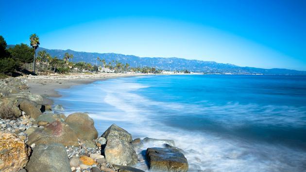 A sandy and rocky beach in Santa Barbara, California.