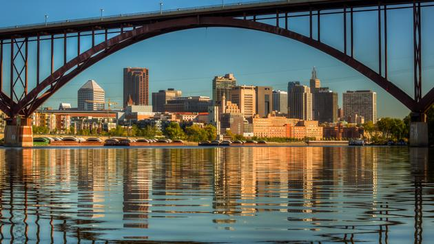 A view of downtown St. Paul in the morning with still water from the Mississippi River with reflection from the High Bridge. (photo via culbertson / iStock / Getty Images Plus)