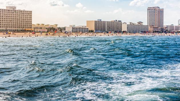 View of Virginia Beach and hotels from the ocean (photo via eurobanks / iStock / Getty Images Plus)