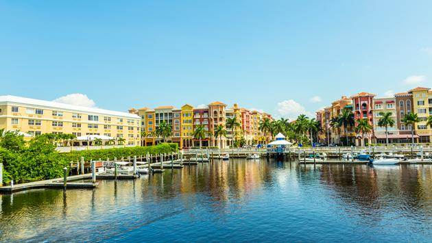 Colorful Spanish influenced buildings overlooking the water in tropical Naples Florida . (Meinzahn / iStock / Getty Images Plus)