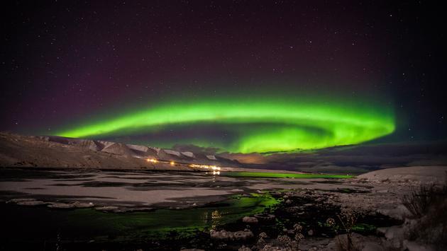 The aurora borealis seen from Akureyri in Northern Iceland. (photo via BENJAMINHARDMAN/iStock/Getting Images Plus)