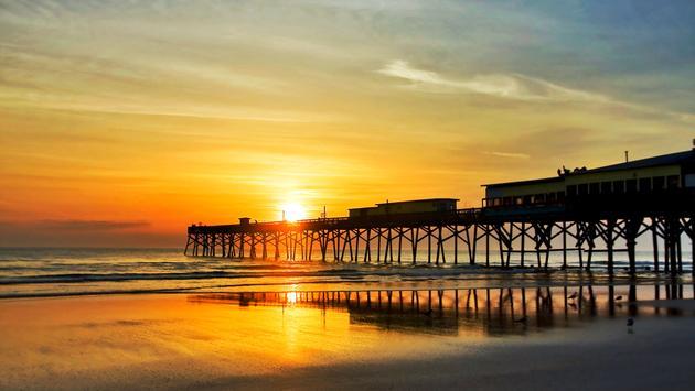 Sunrise in Daytona Beach, Florida, USA (photo via UWMadison / iStock / Getty Images Plus)