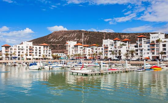 Boats at the Marina harbour in Agadir. Agadir is a major city in Morocco located on the shore of the Atlantic Ocean, near the Atlas Mountains. (photo via saiko3p/iStock/Getty Images Plus)