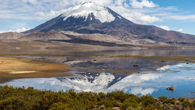 Parinacota volcano and Chungara lake, Lauca National Park (Chile) (Photo Via AlbertoLoyo / iStock / Getty Images Plus)