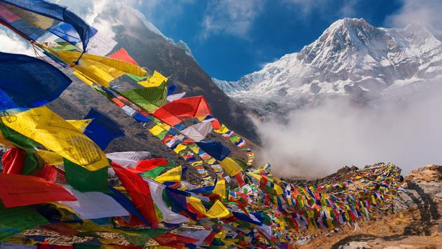 Prayer flags and Mt. Annapurna I background from Annapurna Base Camp ,Nepal. (Devilkae / iStock / Getty Images Plus)