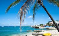View of George Town coastline on Grand Cayman island (photo via virsuziglis/iStock/Getty Images Plus)