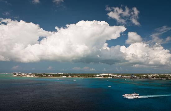 Aerial view of a coastline of Grand Cayman, Cayman Islands (photo via unclegene/iStock/Getty Images Plus)