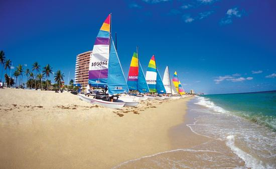 Six catamarans on Ft. Lauderdale beach, Florida, USA (photo via Medioimages/Photodisc / Photodisc)