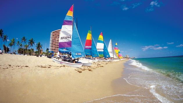 Six catamarans on Ft. Lauderdale beach, Florida, USA (photo via Medioimages/Photodisc / Photodisc)