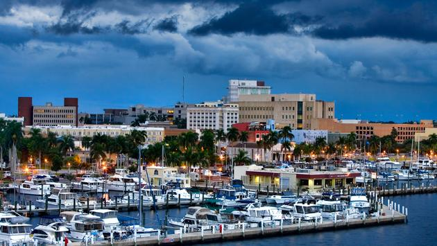 Overlooking downtown Fort Myers, Florida with the yacht basin in the foreground. Typical summer late afternoon with storm clouds lingering. (photo via fotoguy22 / iStock / Getty Images Plus)