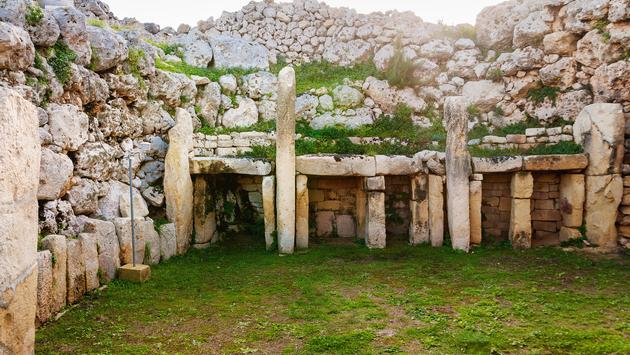 Neolithic megalith temple complex of Ggantija (Tempji Neolitici Tal-Ggantija, 'Giant Tower') on the island of Gozo in Malta. UNESCO World Heritage Site. (photo via Aksenovko / iStock / Getty Images Plus)