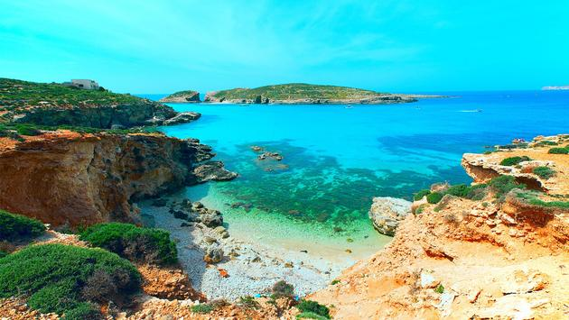 blue lagoon Comino island Malta Gozo (photo via luchschen / iStock / Getty Images Plus)