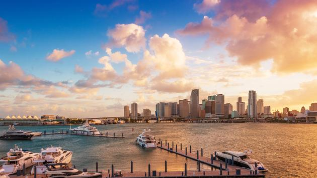 Downtown Miami, Florida, USA, and the port, seen from MacArthur Causeway at sunset. (photo via Dreamframer / iStock / Getty Images Plus)