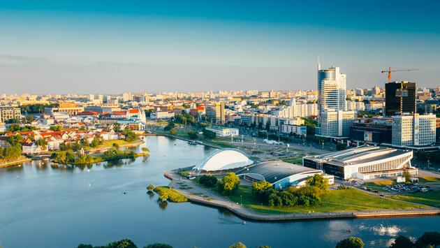 Aerial view, cityscape of Minsk, Belarus. Summer season, sunset time. Nyamiha, Nemiga district (Photo via bruev / iStock / Getty Images Plus)