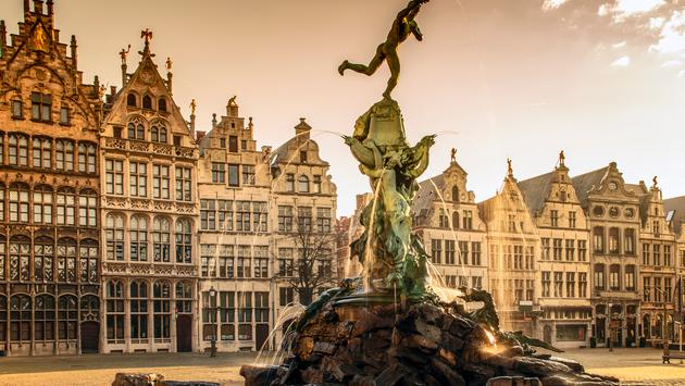 Brabo fountain in front of the town hall on the Great Market Square of Antwerp, Belgium (Photo via littlewormy / iStock / Getty Images Plus)