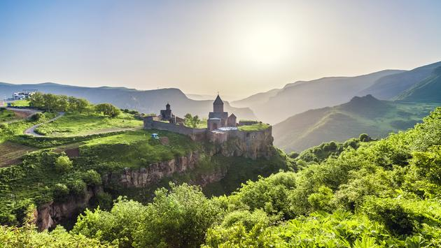 Ancient monastery in setting sun. Tatev. Armenia (Photo via goinyk / iStock / Getty Images Plus)