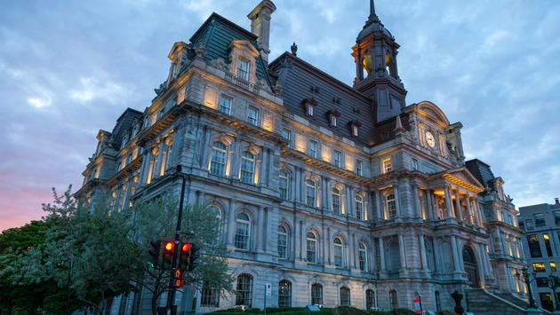 Montreal city Hall at dusk in historical Old Montreal, Canada. (Patrick_Lauzon / iStock / Getty Images Plus)
