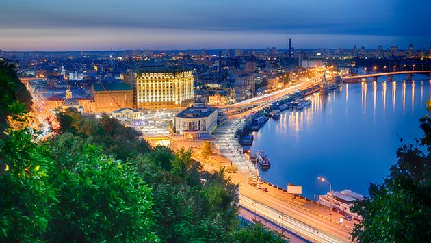 Beautiful View of the Dnieper river, River station, Havana bridge and Naberezhno-Kreschatitska street in Kiev, Ukraine. Night panorama of Kyiv (Photo via connect11 / iStock / Getty Images Plus)