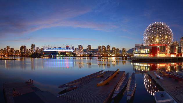 Vancouver Science World and BC Stadium at night (photo via kongxinzhu / iStock / Getty Images Plus)