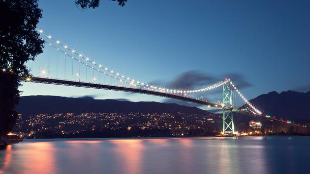 Lions Gate Bridge from the seawall in Stanley Park in Vancouver, BC. (photo via Eric_Z / iStock / Getty Images Plus)