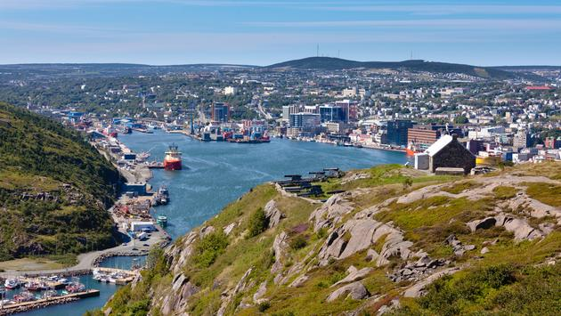 St. John's, capital of Newfoundland Labrador, NL, Canada, harbor and downtown seen from signal hill (Photo via Pi-Lens / iStock / Getty Images Plus)