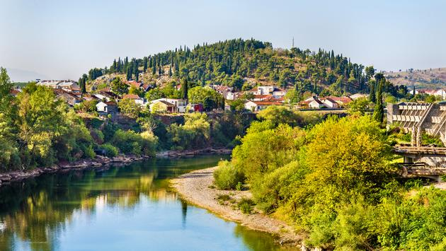 View of Podgorica with the Moraca river - Montenegro (Leonid Andronov / iStock / Getty Images Plus)