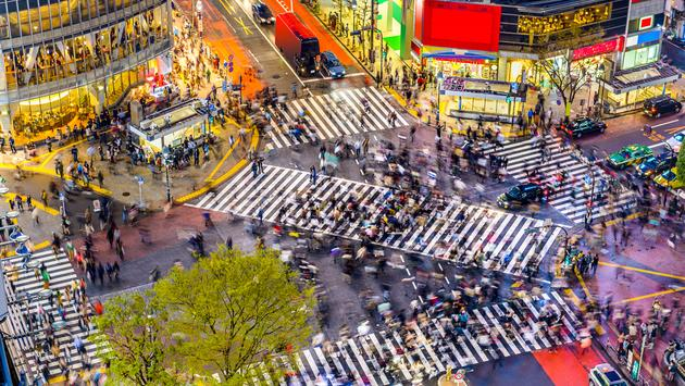 Tokyo, Japan view of Shibuya Crossing, one of the busiest crosswalks in the world. (photo via SeanPavonePhoto / iStock / Getty Images Plus)