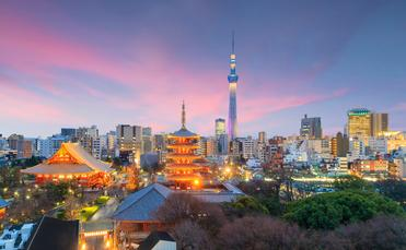 View of Tokyo skyline at sunset in Japan. (photo via f11photo / iStock / Getty Images Plus)