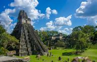 Ruins in the MAya City Tikal in Guatemala.  (photo via SimonDannhauer/iStock/Getty Images Plus)