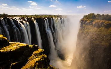 Victoria falls in Zimbabwe (photo via Tamer_Desouky / iStock / Getty Images Plus)