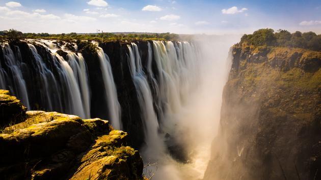 Victoria falls in Zimbabwe (photo via Tamer_Desouky / iStock / Getty Images Plus)