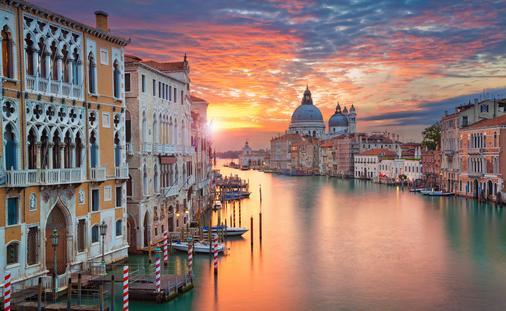 Image of Grand Canal in Venice, with Santa Maria della Salute Basilica in the background. (photo via RudyBalasko / iStock / Getty Images Plus)