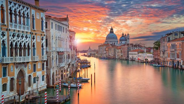 Image of Grand Canal in Venice, with Santa Maria della Salute Basilica in the background. (photo via RudyBalasko / iStock / Getty Images Plus)