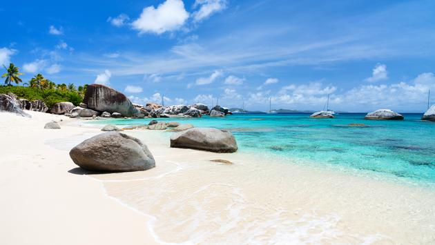 Beautiful tropical beach with white sand, turquoise ocean water and blue sky at Virgin Gorda, British Virgin Islands in Caribbean (Photo via shalamov / iStock / Getty Images Plus)