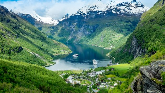 Geiranger fjord, Beautiful Nature Norway. It is a 15-kilometre (9.3 mi) long branch off of the Sunnylvsfjorden, which is a branch off of the Storfjorden (Great Fjord). (cookelma / iStock / Getty Images Plus)