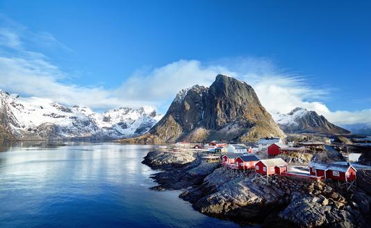 Fishing huts at spring day - Reine, Lofoten islands, Norway (IakovKalinin / iStock / Getty Images Plus)