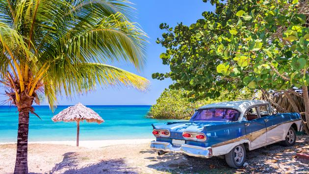 Vintage american oldtimer car parked on a beach in Cuba (Photo via Delpixart / iStock / Getty Images Plus)