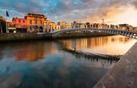 Sunset in Dublin, Ireland (photo via yktr / iStock / Getty Images Plus)