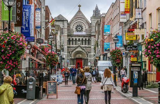 Shoppers on Grafton Street. Dublin, Ireland (photo via jamegaw / iStock / Getty Images Plus)