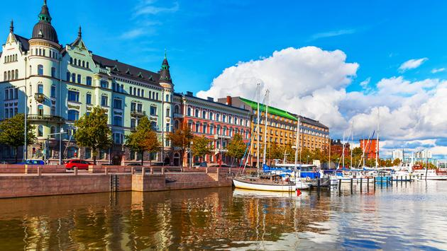 Scenic summer view of the Old Port pier architecture with ships, yachts and other boats in the Old Town of Helsinki, Finland (photo via scanrail / iStock / Getty Images Plus)