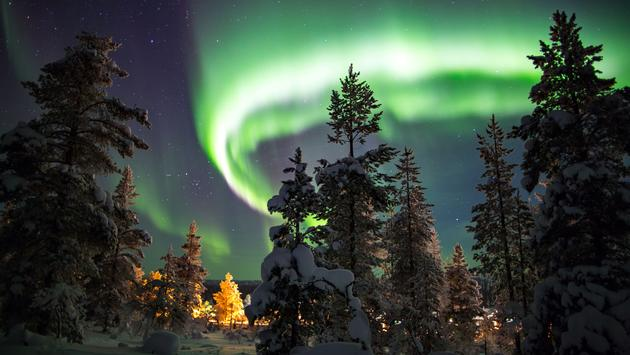 Aurora borealis in Lapland, Finland. (photo via victormaschek / iStock / Getty Images Plus)