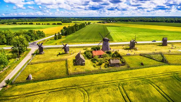 Saarema Island, Estonia: beautiful aerial top view of summer fields and Angla windmills in Leisi Parish (photo via Krivinis / iStock / Getty Images Plus)